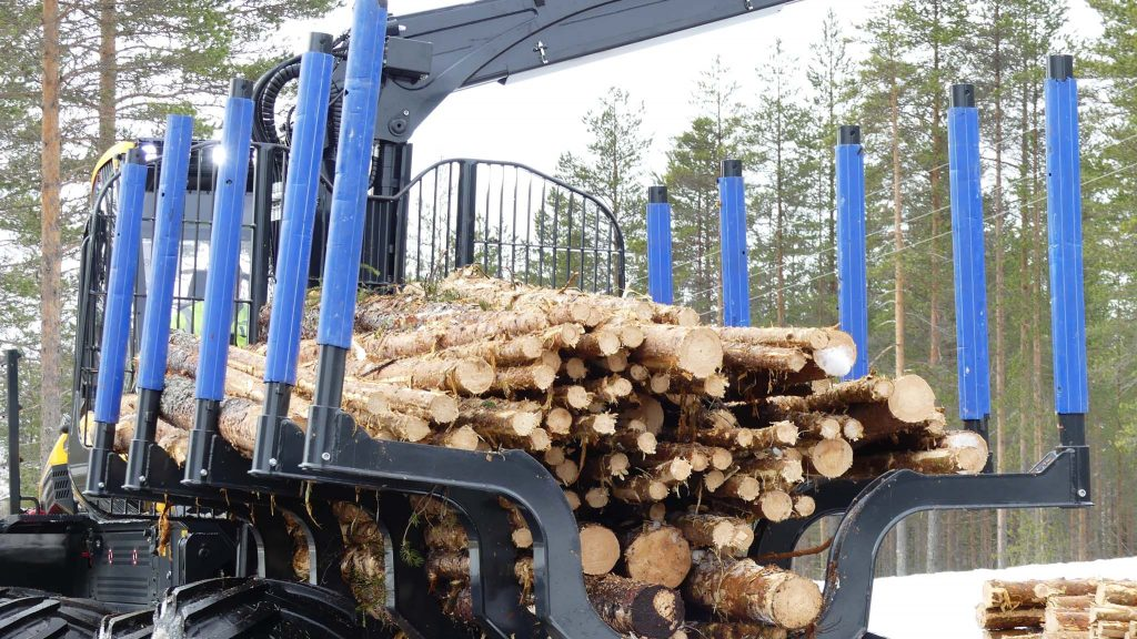 Ponsse Buffalo forwarder in the test forest. The blue pipes works as paint protection.